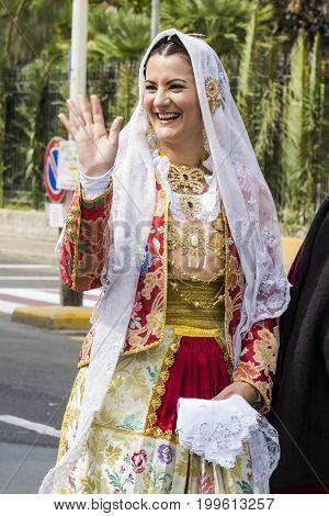 SELARGIUS, ITALY - SEPTEMBER 13, 2015: Ancient Selangor Marriage - portrait of a beautiful smiling woman wearing a traditional Sardinian costume - Sardinia