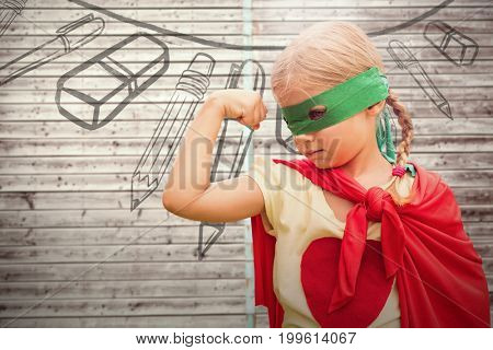 Girl in red cape showing muscles against digitally generated grey wooden planks