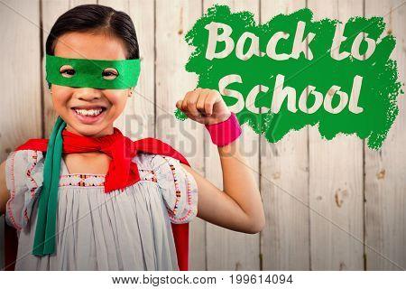 Portrait of girl wearing eye mask against wooden background