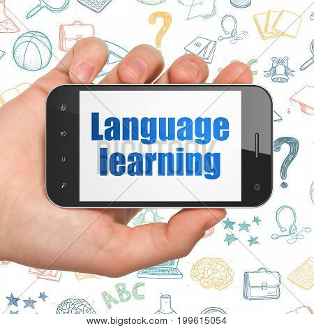 Learning concept: Hand Holding Smartphone with  blue text Language Learning on display,  Hand Drawn Education Icons background, 3D rendering