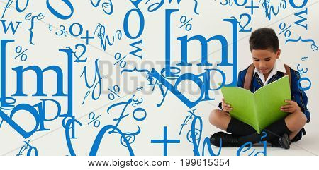 letter and number jumble against schoolboy reading book on white background