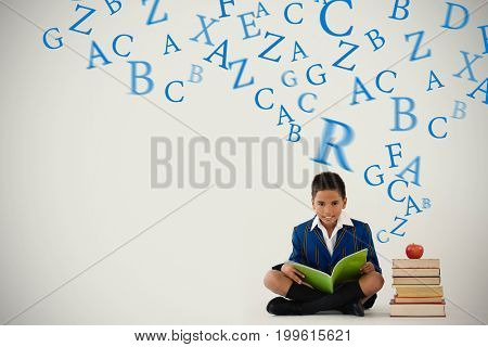 letters against schoolboy studying against white background