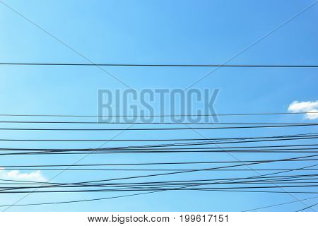 Close up of wires on blue sky