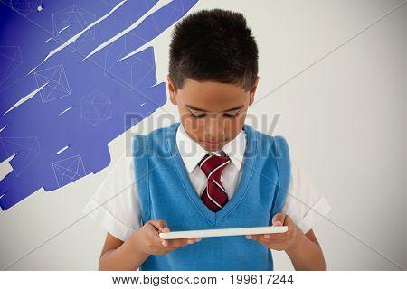 Geometric shapes on black scribbling against schoolboy using digital tablet