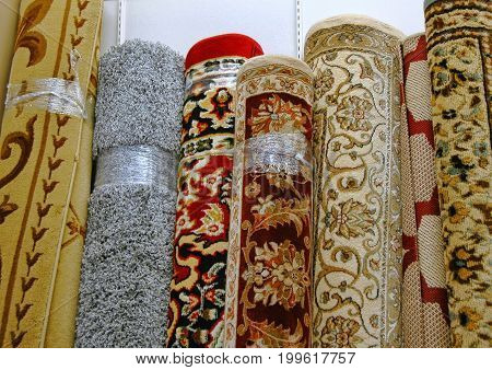 Typical mass market floor coverings for sale in a surplus store