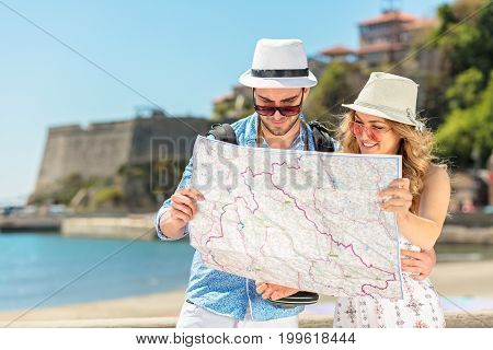 Couple tourist traveling and using map. Couple tourist exploring a city