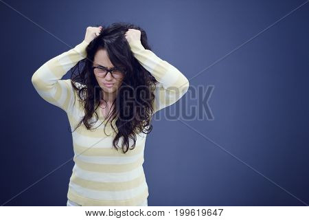 Secretary or business woman with suprised look on her face isolated over dark background.
