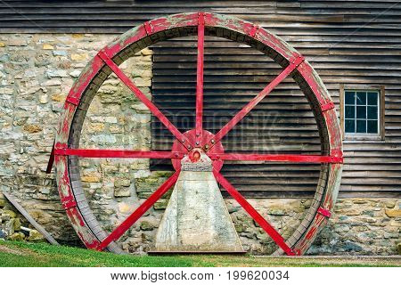 The water wheel on the side of a Wisconsin mill.