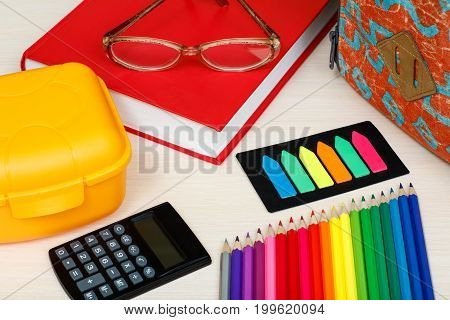 School Supplies. School Backpack, Book, Glasses, Color Pencils, Sandwich Box, Calculator And Color B
