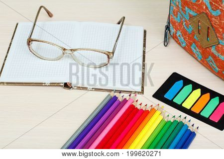 School Supplies. School Backpack, Color Pencils, Notebook With Glasses And Color Bookmarks On Wooden