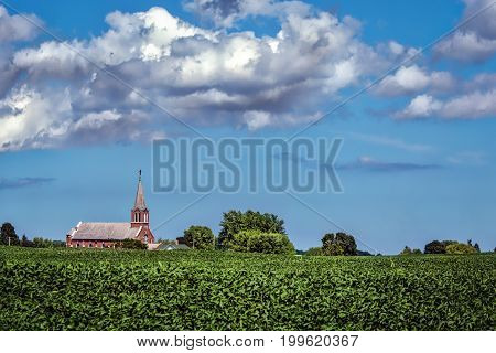 A church stands out on the Wisconsin countryside.
