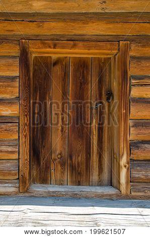 Wooden door of old russian house in summer