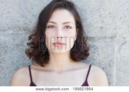 Beautiful caucasian woman with long dark hair outdoor in the summer