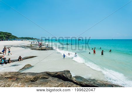 Rayong, Thailand - March 16, 2014 : tourists enjoying  beach  on March 16, 2014 in Rayong, Thailand.