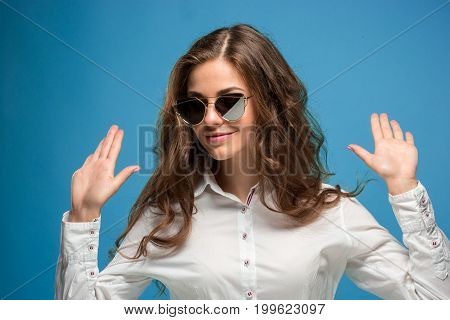 The portrait of disaffected young woman at studio with sunglasses