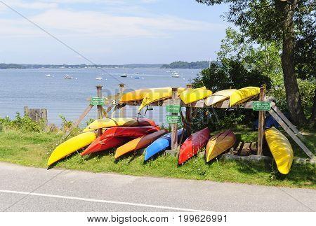 Portland Maine USA - August 10 2009: Kayak rental rack on Eastern Promenade Trail overlooking Casco Bay
