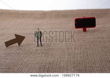 Figurine  Man Beside Holding A Notice Board