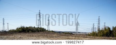 Power line in nature and sky landscape Technology concept