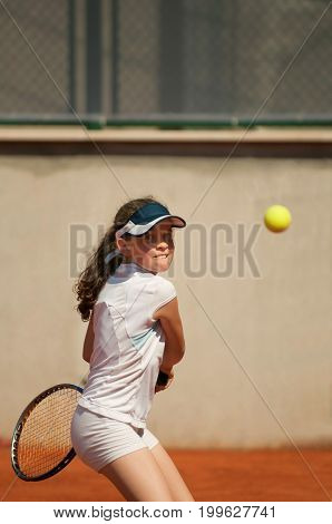 Young Girl Hitting The Ball With Backhand Slice, Toned Image