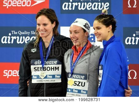 Hong Kong China - Oct 30 2016. SEEBOHM Emily (AUS) Katinka HOSSZU (HUN) and ZEVINA Daryna (UKR) at the Victory Ceremony of the Women's Backstroke 100m. FINA Swimming World Cup.