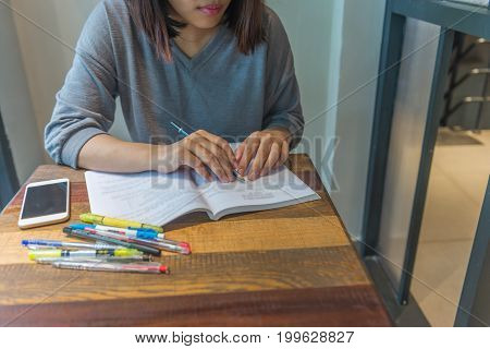 Young student doing homework at the library