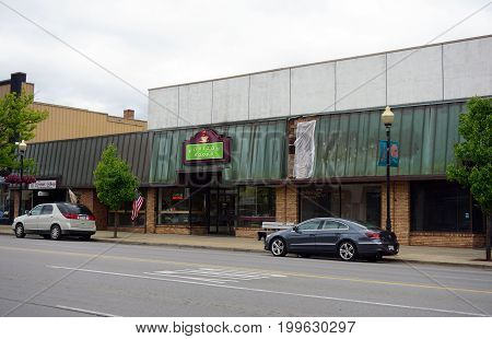 CADILLAC, MICHIGAN / UNITED STATES - MAY 31, 2017:  One may purchase books and drink coffee at Horizon Books, on Mitchell Street in Downtown Cadillac.