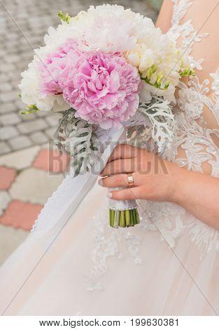 Bouquet in the hands of bride.