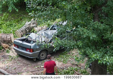 Crumpled car after an accident and man