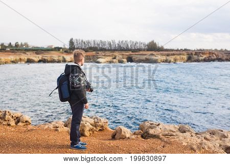 Young photographer on the beach. Traveler photographer with digital camera