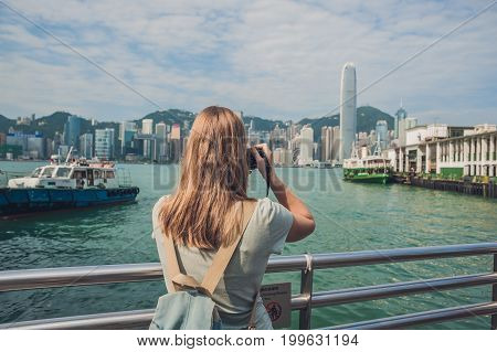 Young Woman Taking Photos Of Victoria Harbor In Hong Kong, China