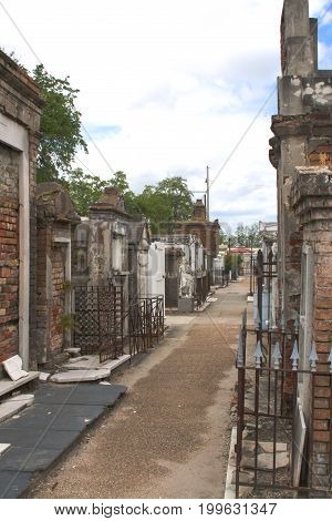 Old cemetery walkway and tombs in New Orleans