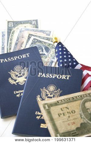 US passports with flag and Cuban currency