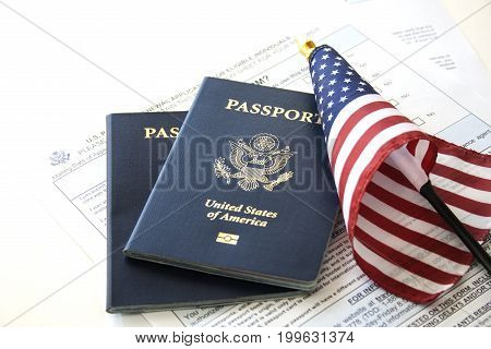 US Immigration/travel concept, passports, flag and renewal form