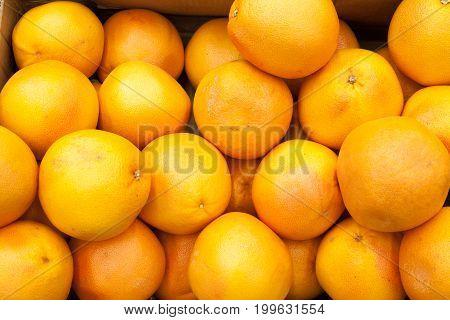 Ripe orange fruit oranges background oranges in a shop window selling oranges