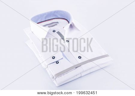 Men's shirts are white folded new on a white background
