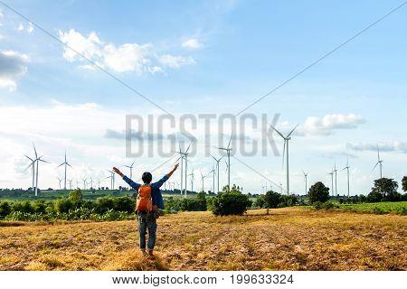 Men standing looking at the field Wind turbine Wind generator Wind power unit Wind energy converter