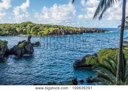 A view of the water and point at Waianapanapa State Park on Maui Hawaii.