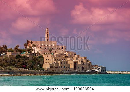 View of old houses, St Peter's belfry and Mediterranean sea in Jaffa, Israel.
