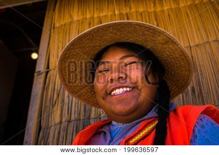Local woman from Uros village in Puno, Peru