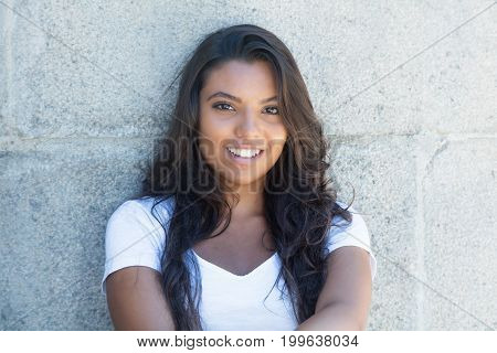Beautiful latin american woman with long hair outdoor in the summer