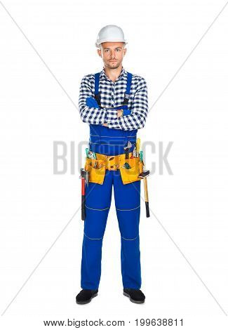 Full Length Portrait Of Confident Construction Worker In Uniform With Crossed Arms