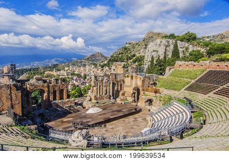 General view of the taormina theater the city of taormina and Sicilian territory background