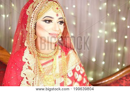 Beautiful brunette portrait with traditional costume. Indian style.