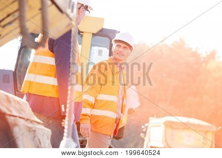 Supervisors discussing while walking at construction site