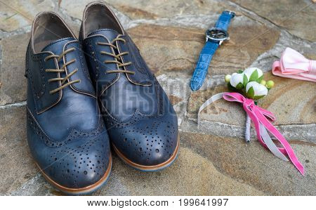 Blue Leather Groom Shoes, Watches, Boutonniere And Pink Bowtie On Brown Natural Stone. Groom Wedding