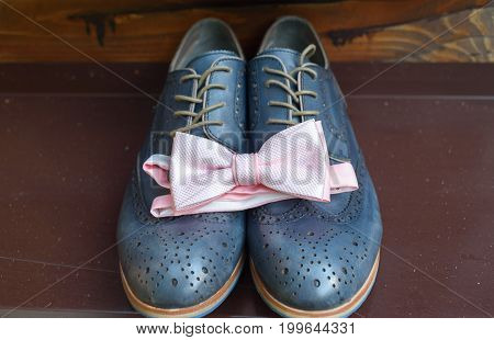 Close Up Of Pink Bowtie On Blue Leather Shoes. Modern Man Accessories. Wedding Details. Groom Access