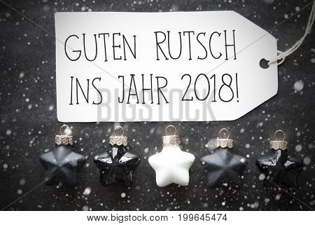 Label With German Text Guten Rutsch Ins Jahr 2018 Means Happy New Year 2018. Black And White Christmas Tree Balls On Black Paper Background With Snowflakes. Christmas Decoration With Flat Lay View
