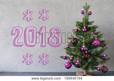 Christmas Tree With Purple Christmas Tree Balls. Card For Seasons Greetings. Gray Cement Or Concrete Wall For Urban, Modern Industrial Styl. Text 2018 For Happy New Year
