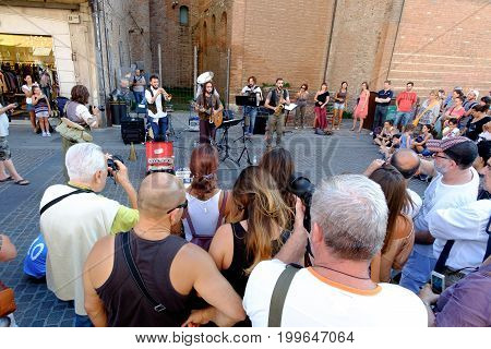 FERRARA Italy - August 27 2016: Buskers Festival 2016 in Ferrara Emilia Romagna Italy. Busker Festival is a popular event with street artists which is held annually in the historic center of Ferrara.In the picture a musician playing the accordion