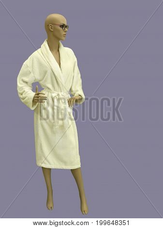 Female mannequin wearing yellow bathrobe. Isolated on white background